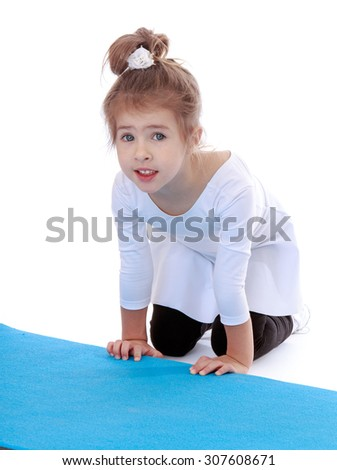 Sweet little grey-eyed girl with braided hair in a bun , doing gymnastics on the Mat-Isolated on white background