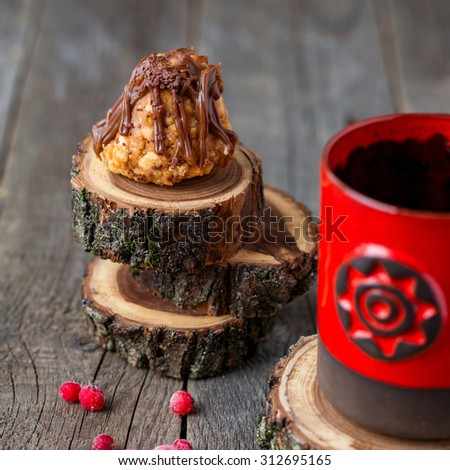 sweet little pastry with redcurrants and a mug on rustic wooden background - stock photo