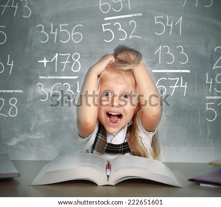 sweet little school girl pulling her blonde hair in stress getting crazy with maths calculation studying doing homework in children education concept on blackboard full of numbers - stock photo