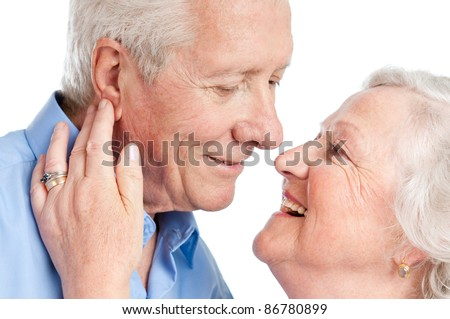 Sweet loving senior couple flirting together during the old age isolated on white background - stock photo