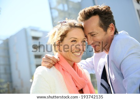 Sweet loving 40-year-old couple in urban area - stock photo