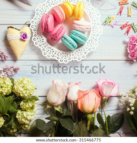 Sweet macarons and flowers - preparation of present - stock photo