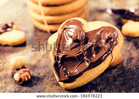 Sweet melting nougat cream on the cookie.Selective focus on the nougat cream on cookie - stock photo