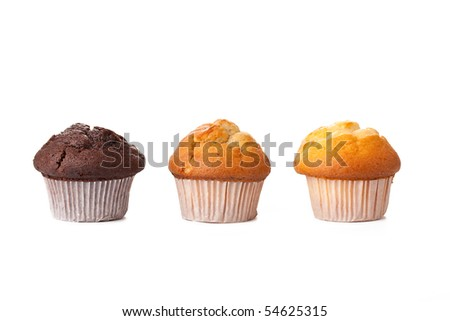sweet muffins on white background - stock photo