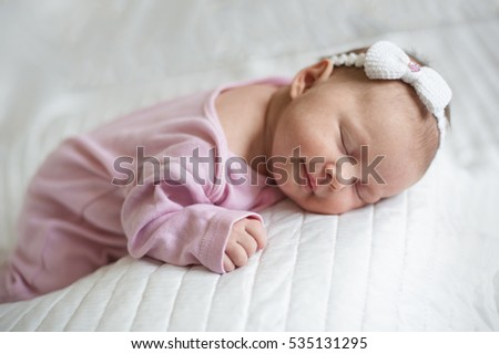 Sweet newborn baby sleeping and smiling