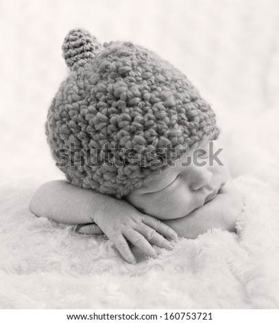 sweet newborn baby sleeping with  hat ( black and white ) - stock photo