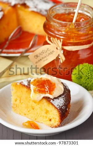 Sweet orange cake and jar of marmalade for breakfast.