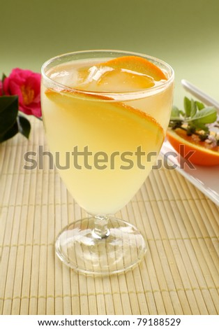 Sweet orange cocktail with ice and slices of fresh orange ready to serve.