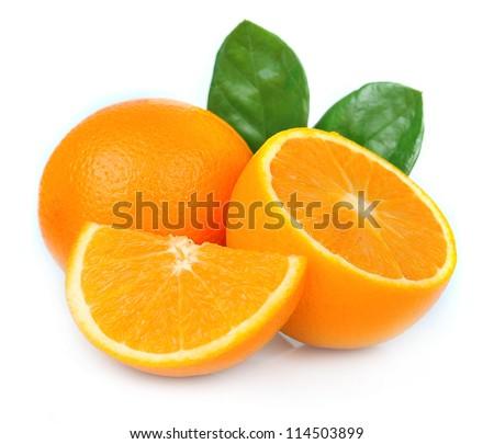 Sweet orange fruit with leaves on white - stock photo