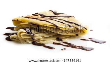 Sweet pancake with chocolate on white - stock photo