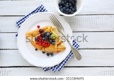 sweet pancakes and berries mix, top view - stock photo