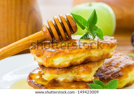 sweet pancakes with apples and honey on a plate - stock photo