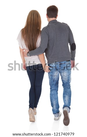 Sweet partners hold each others' hands while walking. - stock photo