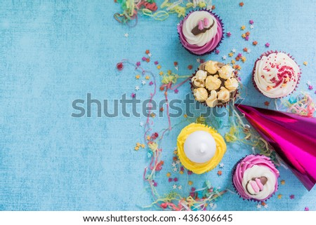 sweet party cupcakes border background, overhead view - stock photo