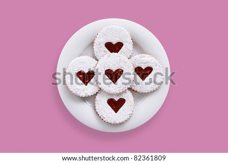 Sweet pastries with jam and icing sugar on a plate