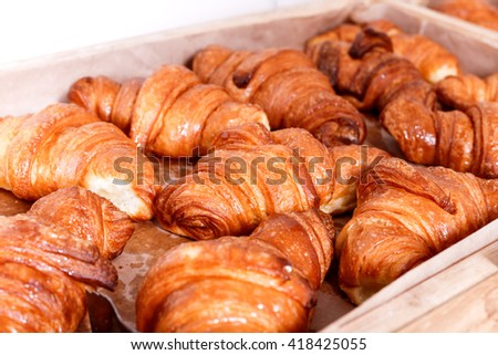 Sweet pastry, Croissants with chocolate and jam filling on shelf in Bakery shop. Pastries and bread in a bakery - stock photo