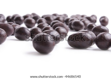 Sweet peanuts in chocolate on white background
