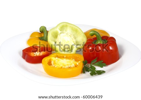 Sweet pepper slices on a plate of different maturity and colors