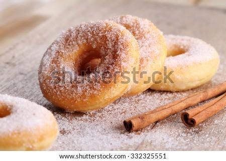 Sweet pieces of sugar doughnuts with cinnamon sugar - stock photo