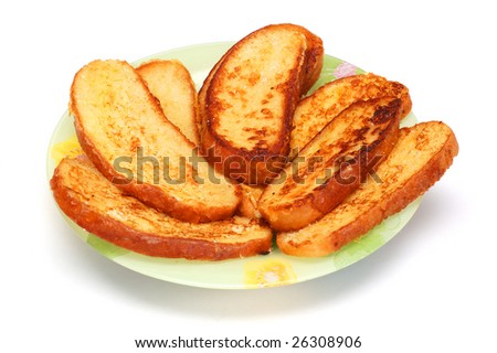 Sweet pieces of toasted bread, fried in egg - stock photo