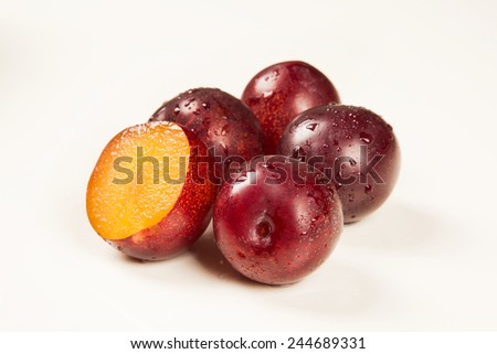 Sweet plums isolated on the white background - stock photo