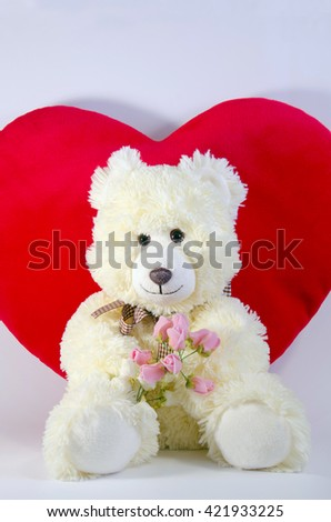 Sweet plush bear with the bouquet of roses and red plush heart