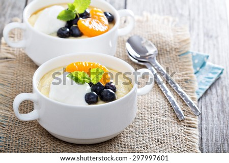 Sweet polenta with blueberries, fruits and yogurt