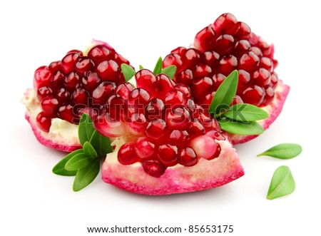 Sweet pomegranate with leafs close up - stock photo