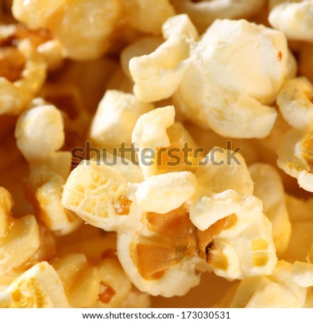 Sweet popcorn background in closeup - stock photo