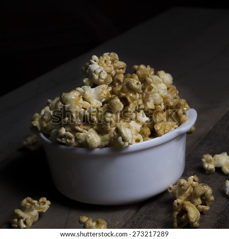 Sweet popcorn snack in the bowl for your rest - stock photo