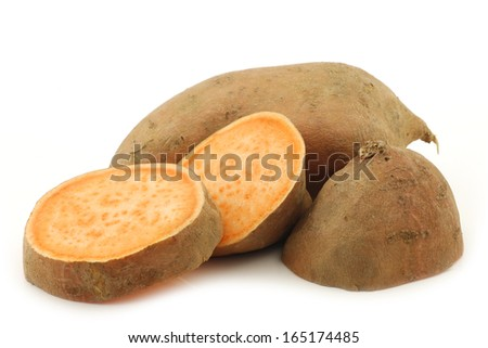sweet potato and a cut one on a white background - stock photo