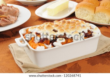 Sweet potato casserole with turkey and dinner rolls - stock photo