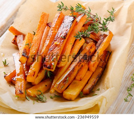 sweet potato fries with  herbs . Selective focus - stock photo