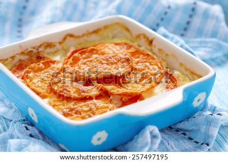Sweet Potato Gratin With Cream In Baking Dish