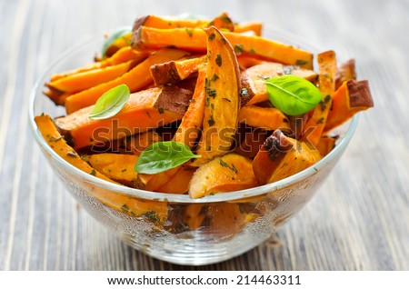 Sweet potato in a bowl on wooden background - stock photo