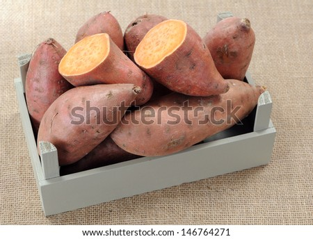 sweet potato in crate on table  - stock photo