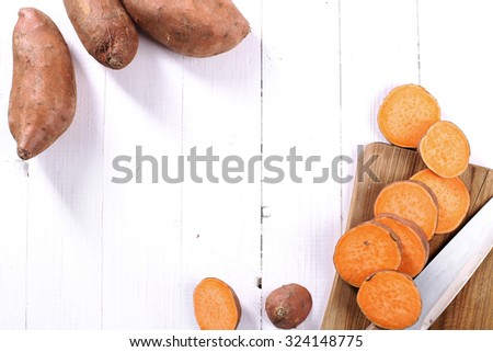 Sweet potato on the wooden table - stock photo