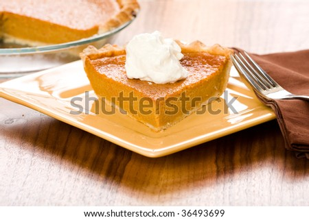 Sweet Potato Pie with a dollop of freshly whipped cream - stock photo