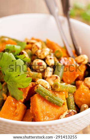 Sweet potato stew with green beans and spicy peanuts - stock photo