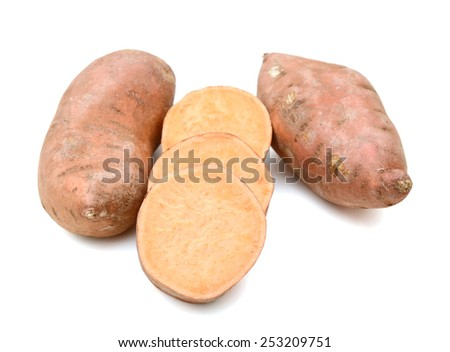 sweet potatoes and slices on white background