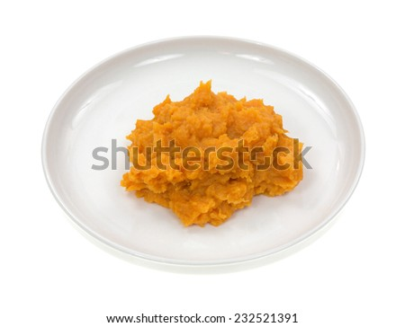 Sweet potatoes on a small plate atop a white background. - stock photo