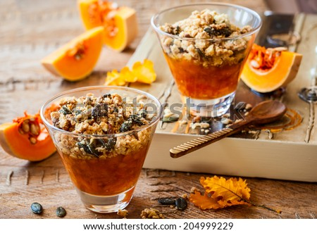 Sweet pumpkin crumble with pumpkin seeds and pine nut - stock photo