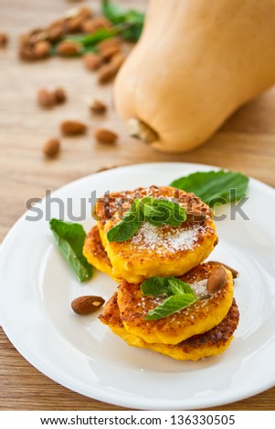 sweet pumpkin pancakes on a plate with mint