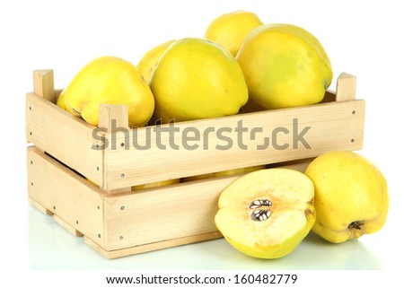Sweet quinces in wooden box isolated on white