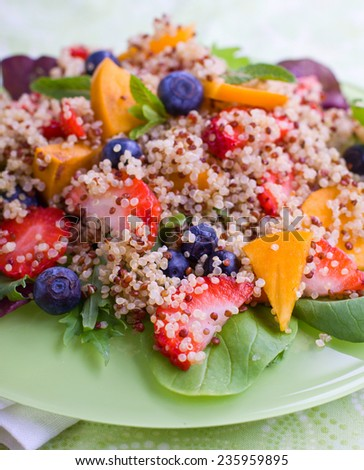 Sweet quinoa salad with berries and fruits, shallow depth of field, selective focus - stock photo