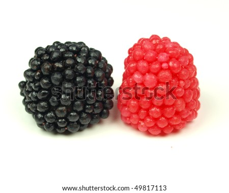 Sweet raspberry and blackberry bonbons on white background