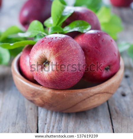 Sweet red apple on the wooden table, selective focus - stock photo