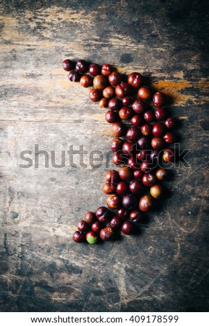 Sweet red cherries on wooden table, Moon Shape - stock photo