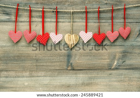 Sweet red hearts hanging on wooden background. Valentines Day concept - stock photo