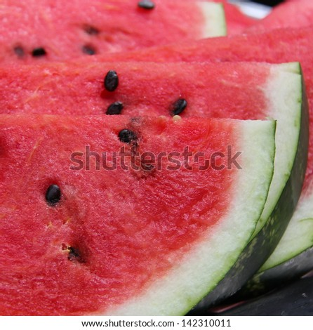 Sweet red slices of watermelon, Borough Market, London England - stock photo